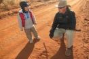 Studying animal tracks with Madikwe Safari Lodge guide